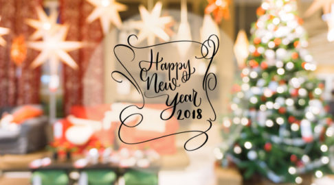 2018-happy-new-year-text-on-colorful-bokeh-blur-background-from-decorated-christmas-tree_1253-1580